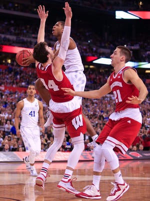UK's Aaron Harrison draws the foul on Wisconsin's Frank Kaminsky late in the second half but the Badgers beat Kentucky 71-64 in the semifinal Saturday at the Final Four at Lucas Oil Stadium. Aaron Harrison finished with 12 points and three rebounds. By Matt Stone, The C-J April 4, 2015.