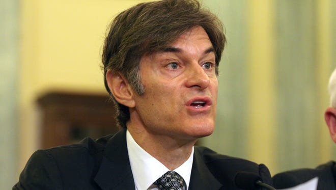 Dr. Mehmet Oz, vice chairman and professor of surgery, Columbia University College of Physicians and Surgeons, testifies on Capitol Hill in Washington on June 17, 2014. Oz is fighting back against critics who are trying to get him removed from a faculty position at Columbia University.