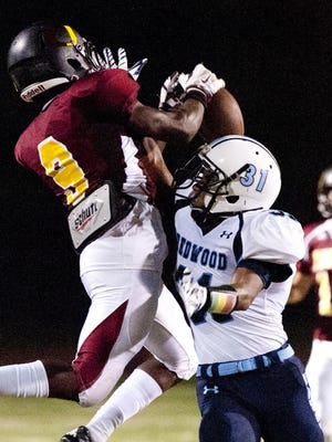 Tulare Union's Emoryie Edwards (9) contests against a Redwood defender for the football in a non-league game in 2015.