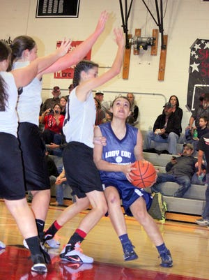 Silver High had some trouble finishing up in the paint Wednesday evening in a scrimmage against Cliff. But, the Cowgirls were pretty tough defensively down there.