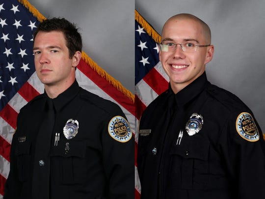Officers Justin Chisholm, left, and Jonathon Sheppard.