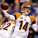 FILE - In this Jan. 4, 2015, file photo, Cincinnati Bengals quarterback Andy Dalton (14) throws a pass during the first half of an NFL wild card playoff football game against the Indianapolis Colts in Indianapolis. Dalton is headed to his second Pro Bowl, replacing the injured Aaron Rodgers. Dalton was a seventh alternate in voting for the Pro Bowl last month. (AP Photo/AJ Mast, File)