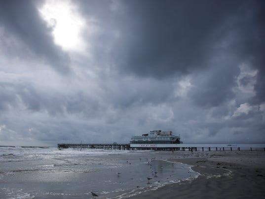 ... and Pier ahead of Hurricane Matthew. (Photo: Will Vragovic, AP