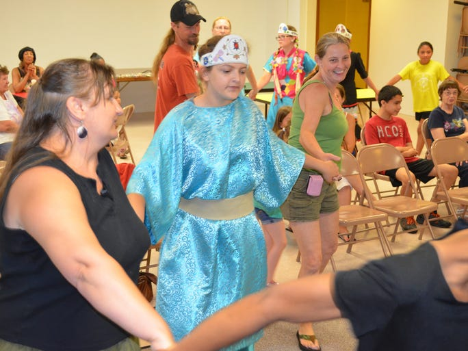 Crystal Ridgway of Fairton, Samantha Ridgway of Fairfield and Kim Overstreet of Vineland weave through the audience during a group dance Saturday at a program presented by the Nanticoke Lenni-Lenape Tribal Nation.