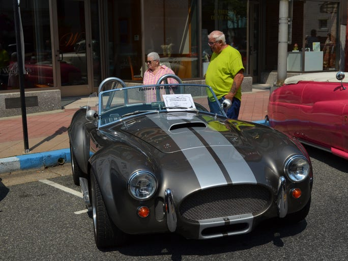 Emily Wilson and Bob Morris, both of Millville, are annual attendees of the the Downtown Millville Car Show. They were impressed this year by a 1965 Shelby Cobra.