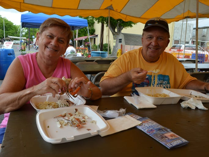 Anna Shimp, formerly of Bridgeton, and Bridgeton Area Chamber of Commerce Executive Director Tony Stanzione grab a bite to eat before the kayak challenge on Saturday.