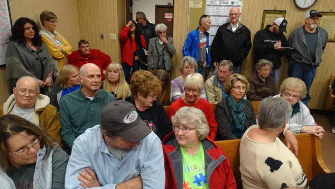 A record crowd overflowed council chambers Tuesday night to weigh in on a request to rezone 4.1 acres on Cambridge Road to allow building 38 townhouses for working families. The Planning Commission unanimously denied that request. The developers have not yet decided whether they will now take their proposal to City Council without the Planning's Commission's blessing.