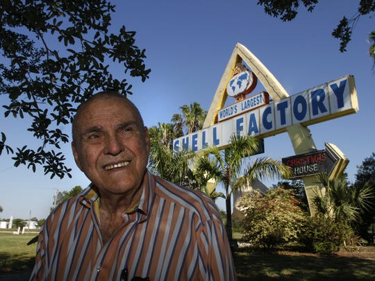 Shell Factory & Nature Park owner Tom Cronin near the iconic sign in North Fort Myers Thursday, April 10.