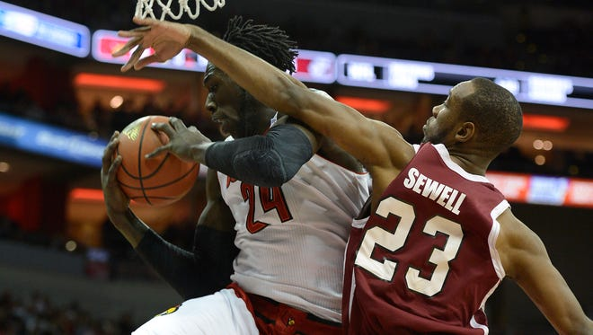 Nov 9, 2014; Louisville, KY, USA; Louisville Cardinals forward Montrezl Harrell (24) battles for a rebound with Bellarmine Knights guard Josh Sewell (23) during the first half at KFC Yum! Center. Mandatory Credit: Jamie Rhodes-USA TODAY Sports