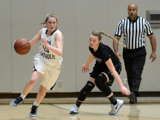 Miranda Jacobson of Marin Catholic takes the ball across the court trailed by U-Prep's Sophia Altemus during their NorCal playoff game in Kentfield on Wednesday.