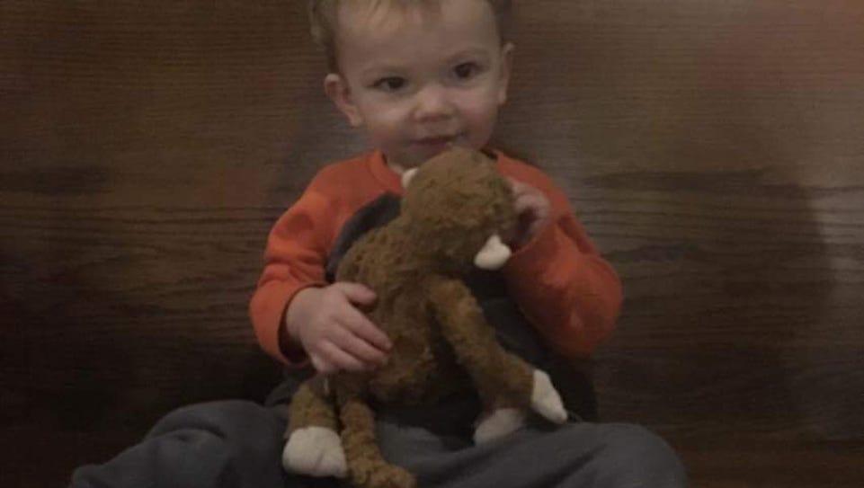 Oscar Radaker, 2, was reunited with his Curious George