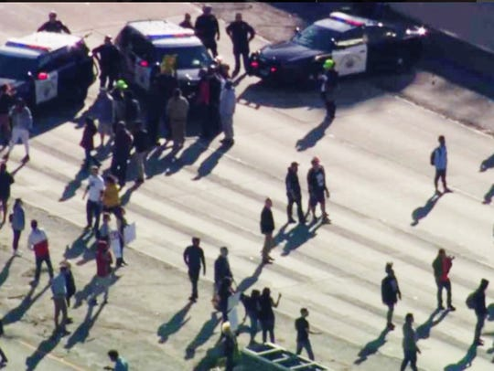 This photo from video provided by KCRA3 shows demonstrators