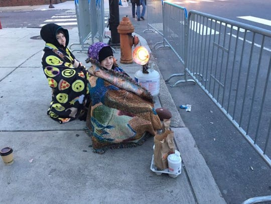 Two kids wait for the Eagles parade to start in South