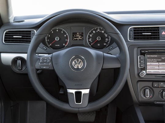 In an otherwise buttoned-down sedan, a leather-wrapped steering wheel, iPod audio input, satellite radio and auto up/down windows add some luxury to the 2014 Volkswagen Jetta TDI Ñ as do cruise control, trip computer and silver metallic trim on the dash and doors.