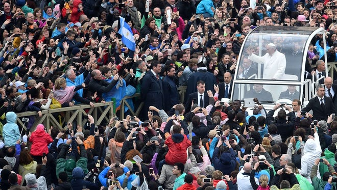 Pope Francis greets the crowd from the popemobile after the Easter Mass at St. Peter's Square on April 5.
