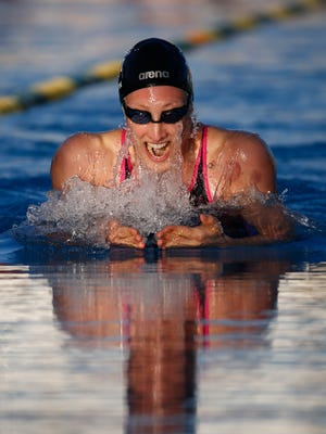 Breeja Larson swims in the women's 100-meter breaststroke final at the Arena Pro Swim Series on Thursday, April 16, 2015 at Skyline Aquatic Center in Mesa.