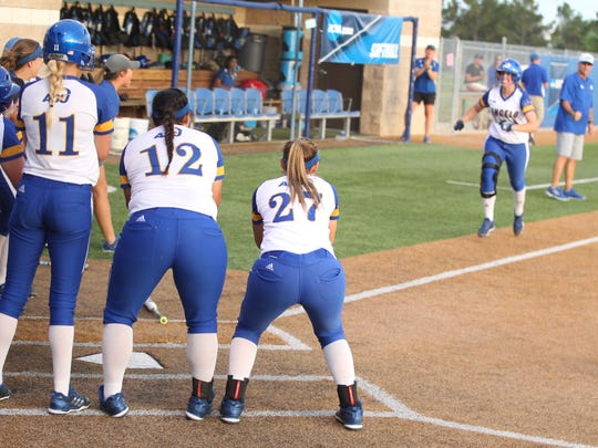 The Angelo State University softball team waits to