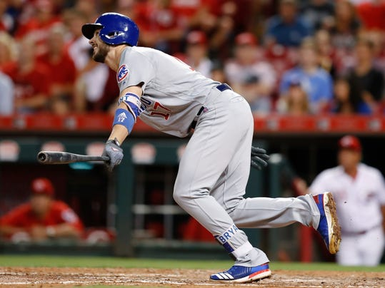 FILE - In this Aug. 22, 2017, file photo, Chicago Cubs' Kris Bryant watches an RBI sacrifice fly off Cincinnati Reds relief pitcher Kevin Shackelford during the fifth inning of a baseball game, in Cincinnati. Last season, Bryant batted .295 with 29 homers and 73 RBIs after winning the NL MVP award in 2016. (AP Photo/John Minchillo, File)