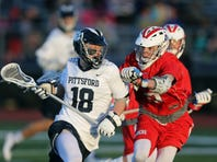 Pittsford's Colby Barker (18) is defended by Fairport's TJ Hendricks during a game April 19, 2016.