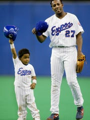 Vladimir Guerrero and his son Vladimir Jr. tip their