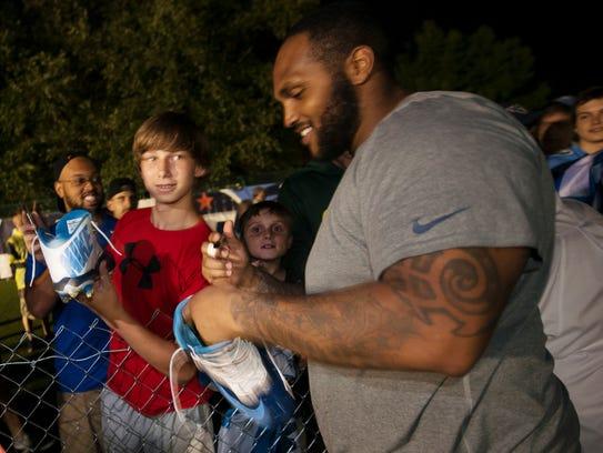 Titans defensive tackle Jurrell Casey (99) signs autographs