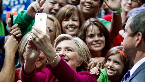 Hillary Clinton takes a selfie with supporters at a