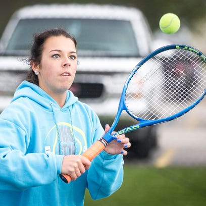 Haleigh Criswell, a Delta tennis player, practices