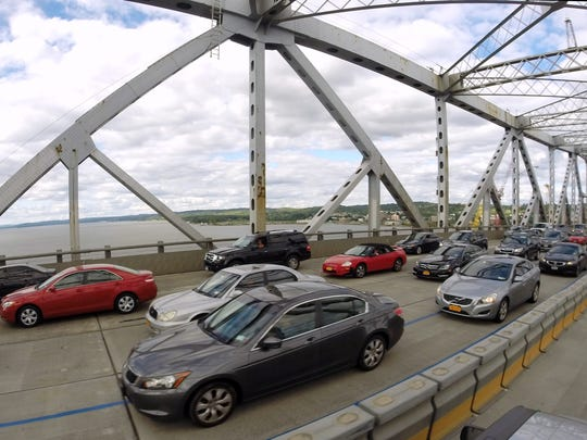 Commuters cross the Tappan Zee Bridge as construction continues for the new span.