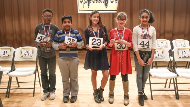 Winners of the 2018 Origin Bank All-Parish Spelling Bee are, from left: fifth place is Jacob Green; fourth place is Saikiran Guruprasad; third place is Sage Bell; second place is Hannah Schaitel; first place is Gauri Vashisht.