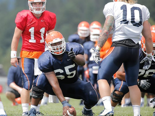 UTEP center Derron Gatewood points out coverage during
