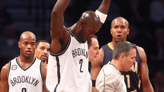 Brooklyn Nets power forward Kevin Garnett (2) reacts after Indiana Pacers power forward David West (21) is called for a technical foul during the first quarter at Barclays Center.