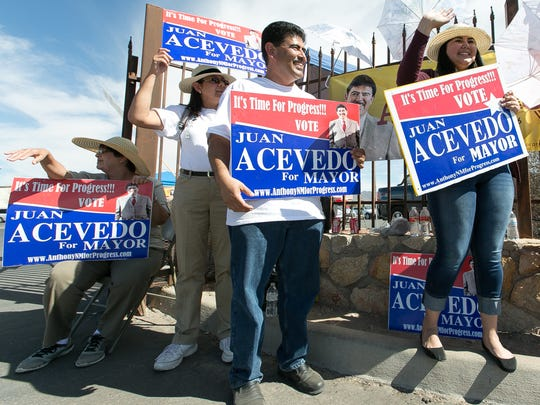 Anthony Mayoral candidate Juan Acevedo, center, greets voters  at the entrance of the City of Anthony Municipal Complex on Tuesday, March 1, 2016, with supporters. Pictured around Acevedo from left is Irma Fernandez, Sarah Acevedo, Valerie Montiel and Francisca Acevedo, all of Anthony, New Mexico.