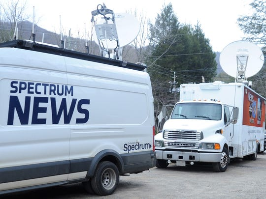 News trucks on Feb. 21 fill the parking lot beside