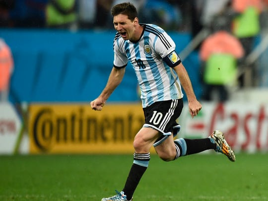 Argentina's Lionel Messi celebrates after winning the shootout Wednesday.