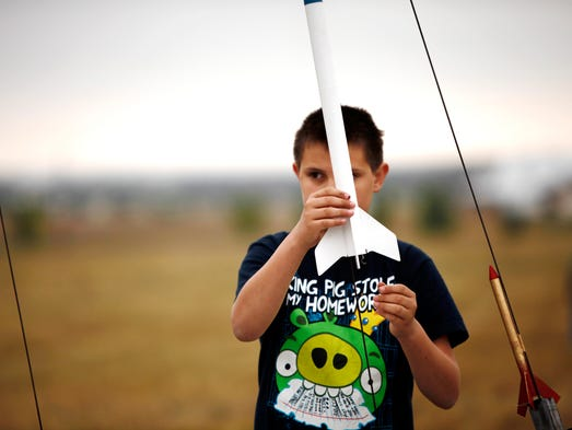 Cody Fitzpatrick, 12, pepares to launch his rocket that he build during the 4-H Model Rocket Fly Day at the Ranch Events Complex, Larimer County Fair grounds Sunday July 27, 2014.