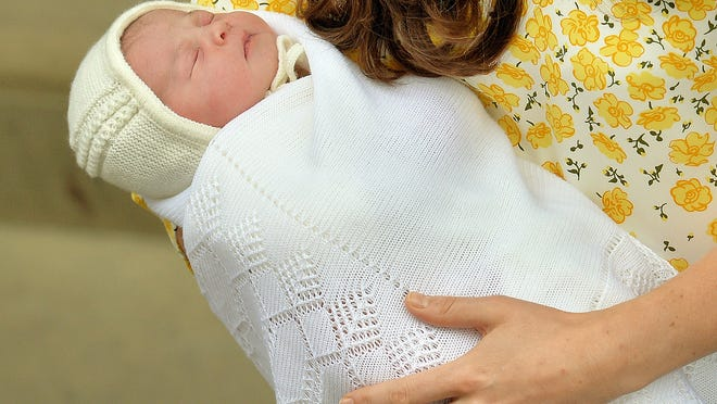 Kate, Duchess of Cambridge holds her newborn baby princess, as she poses for the media on the steps of The Lindo Wing of St. Mary's Hospital, London, Saturday, May 2, 2015. Kate, the Duchess of Cambridge, gave birth to theri second child, a baby girl on Saturday morning.