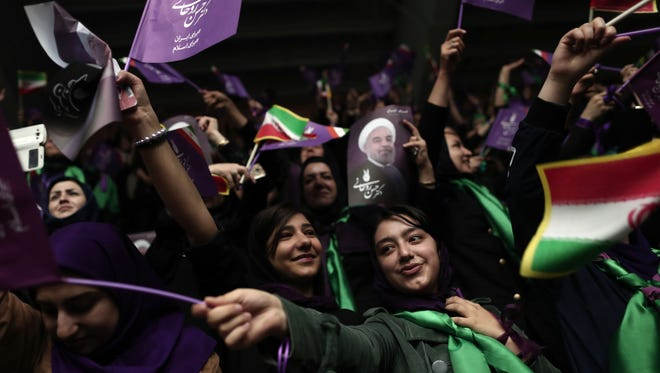 Supporters of Iranian President and candidate in the upcoming presidential elections, Hassan Rouhani, attend a campaign rally in the northwestern city of Ardabil on May 17, 2017.