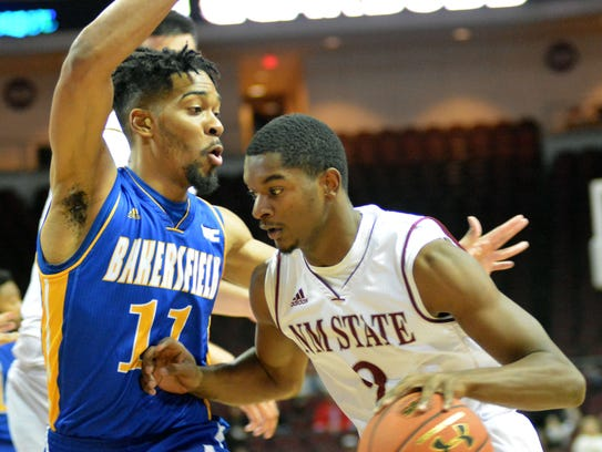 New Mexico State guard Braxton Huggins drives the lane