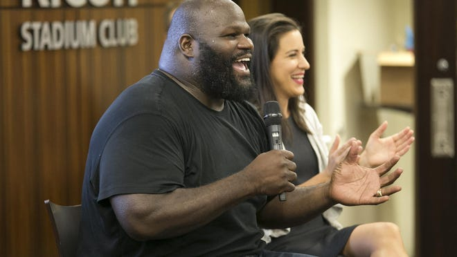 Wrestling legend Mark Henry, pictured with USA Paralympian Lacey Henderson in 2018, is teaming with Positive Coaching Alliance, World Wrestling Entertainment and Austin ISD for Reclaiming Youth Sports 2020, a virtual workout that will feature some familiar faces from the worlds of sports and sports entertainment.