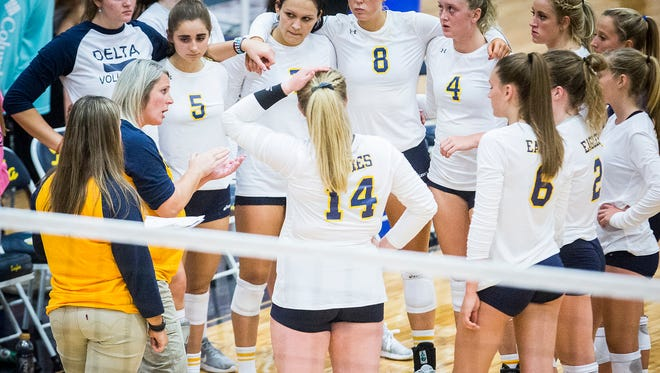 Heidi Knuckles, shown her giving her team instructions during a match in the fall, stepped down as Delta volleyball coach after 11 seasons. She wants to be able to watch her daughter play.