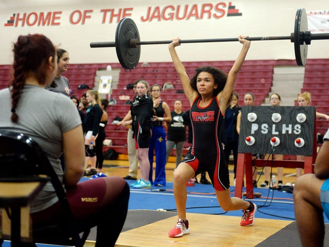 Port St. Lucie High School's Alexandra Chisholm cleans
