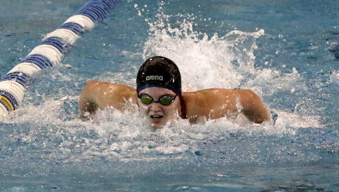 Summer Pierce of Owego swims to seventh place in the 100-yard butterfly preliminaries Friday during the New York State Girls Swimming and Diving Championships at Ithaca College.