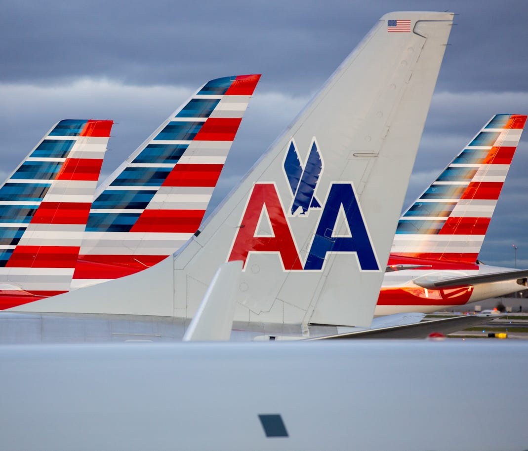 American Airlines tails line up at Terminal 3 at Chicago O'Hare International Airport on Nov. 11, 2016.