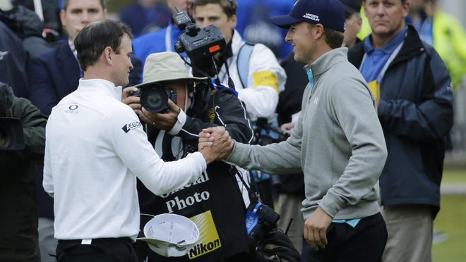 APZach Johnson, left, is congratulated by Jordan Spieth after winning a playoff after the final round of the British Open on July 20. United Statesâ?? Zach Johnson, left, is congratulated by United Statesâ?? Jordan Spieth after winning a playoff after the final round of the British Open Golf Championship at the Old Course, St. Andrews, Scotland, Monday, July 20, 2015. (AP Photo/David J. Phillip)
