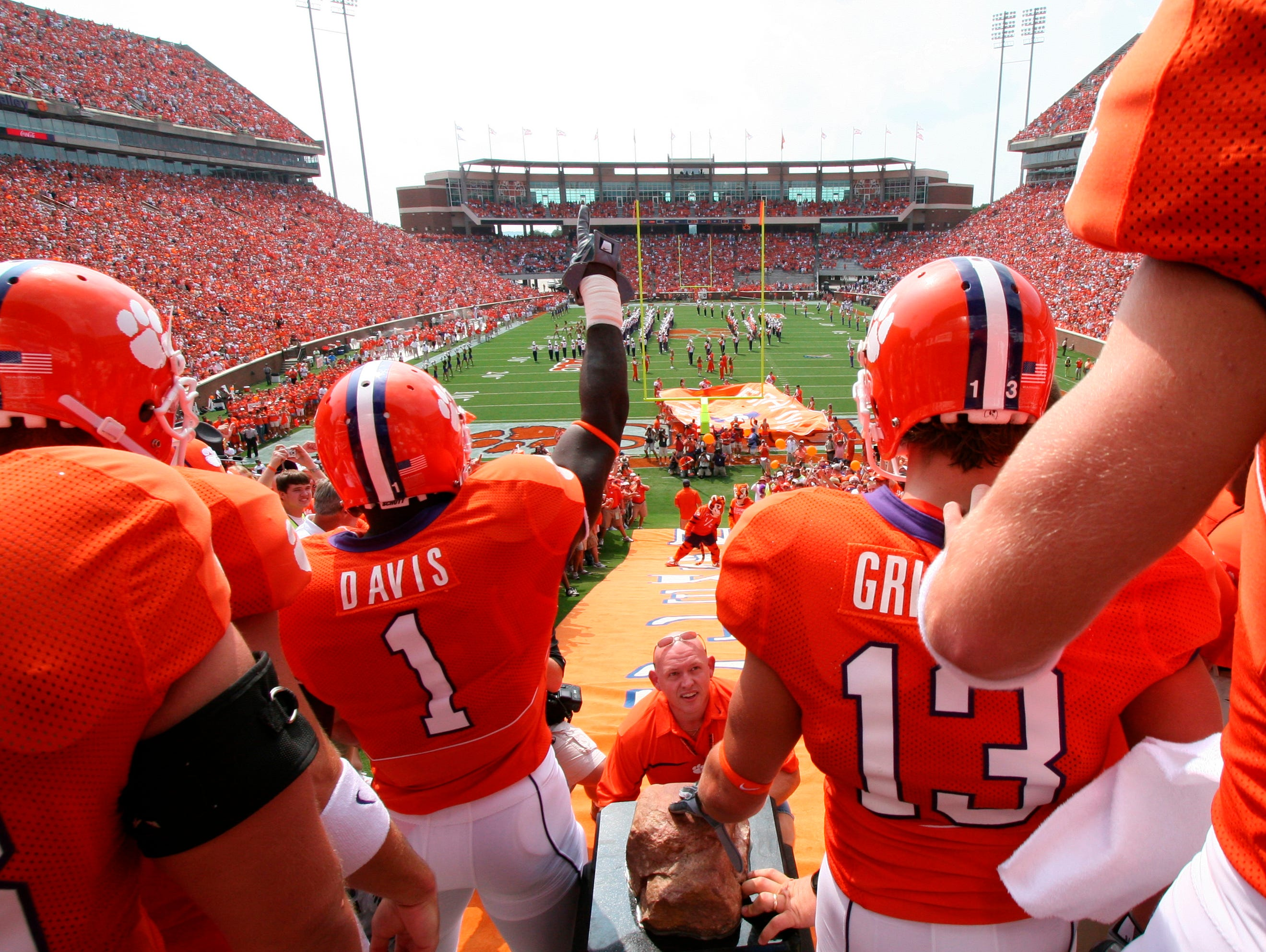 Memorial Stadium, Clemson: Dubbed the 25 most exciting seconds in college football, the Tigers gather at the top of a hill and each player touches Howard's Rock as he sprints down to the field.