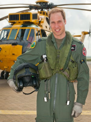 Prince William with a Sea King helicopter at RAF Valley in Anglesey Wales, in 2012.