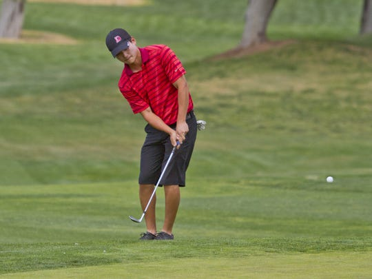Dixie State's Kenny You chips onto the green during the PacWest Conference Championship at Sunbrook Golf Club on April 21.