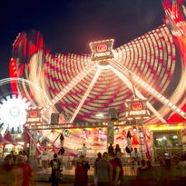Lights from rides at the Arizona State Fair leave trails of light in a one-second exposure.