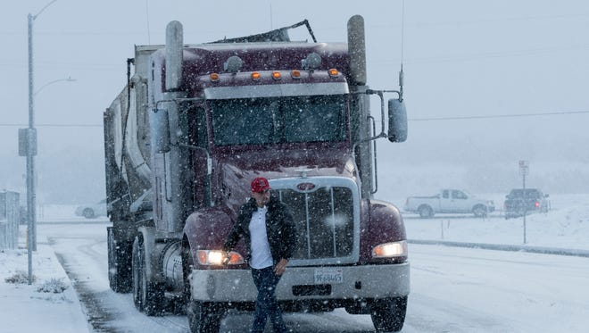A truck driver makes his way through a snow storm which left a few inches of snow in the Cajon Pass and Oak Hills areas  in Hesperia, Calif., Tuesday Feb. 27, 2018. Many of California's mountains are sporting new coats of snow, much of it down to low elevations, from the first of two cold weather systems predicted for the state this week. (James Quigg, Daily Press /The Daily Press via AP) ORG XMIT: CAVIC104