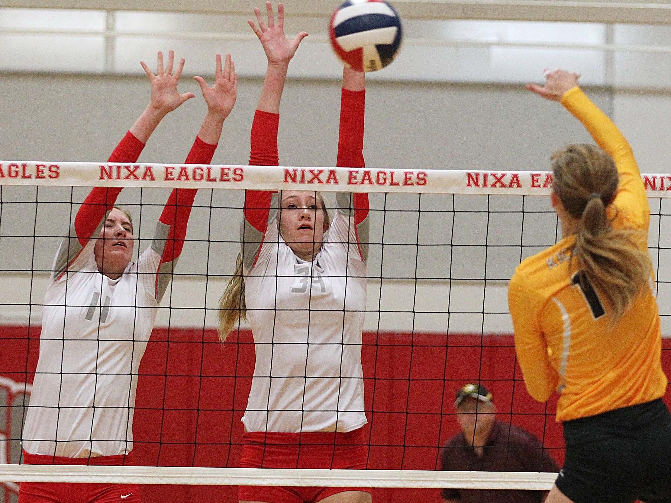 Nixa middle hitter Shelby Johnson, left, signed a letter of intent April 15 to play volleyball for Stephens College.